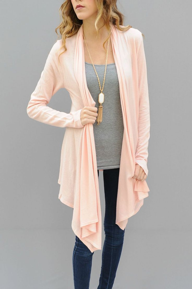 ALMOST GONE! A great piece for fall. A light pink Cardigan to wear with all your fall pieces all season long.