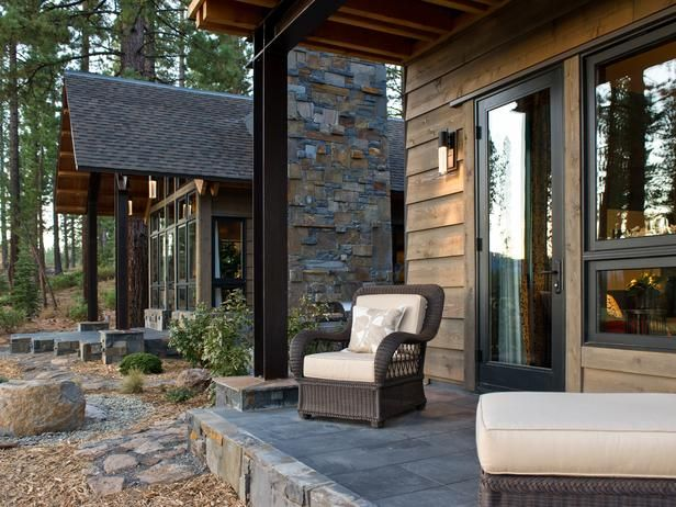 Private covered patios, which extend from each wing, offer a transitional spot between indoors and out. The fountains are clad in the same m...