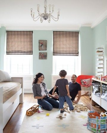 This space was designed to look youthful but not juvenile. The same patterned material was used for the window shades and to make the storage bins.