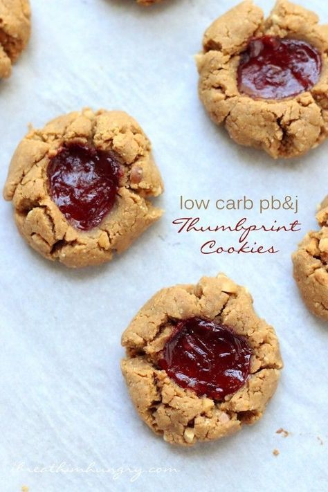 A low carb peanut butter and jelly thumbprint cookie recipe from Mellissa Sevigny of I Breathe I'm Hungry