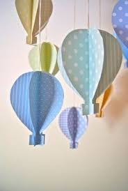 Summer window display: paper hot air balloons maybe oversize these with foamcore.