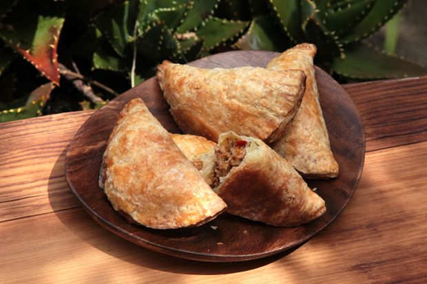 Chicken Empanadas - This version contains braised chicken, olives, and spices, surrounded by a flaky, buttery dough.