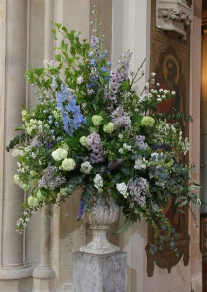 Large abundant church urn- NOT these colours or flowesr
