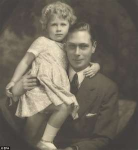 The child Queen (Elizabeth) cuddles her father King George VI