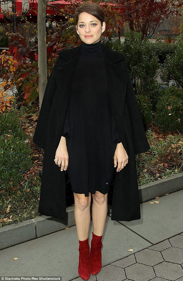 One-upping Dickens: Marion Cotillard was looking mighty fine in the first of three seperate outfits at a screening of Macbeth in New York on Wednesday