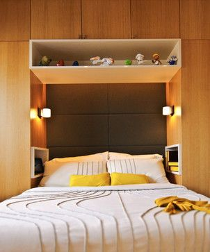 Built in cabinets around bed by Grada inc