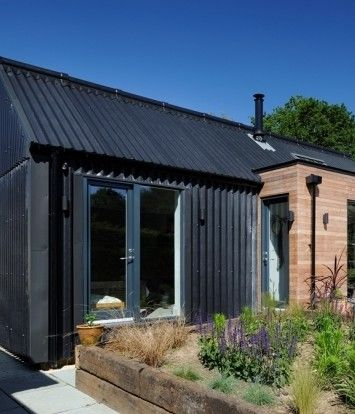 Emerging architects PAD Studio specified the Marley Eternit Profile 6 in black for the roof and façade of Daisybank Cottage in Brockenhurst, to blend with the local New Forest surroundings and to stay true to the corrugated tin cladding used on the original building.