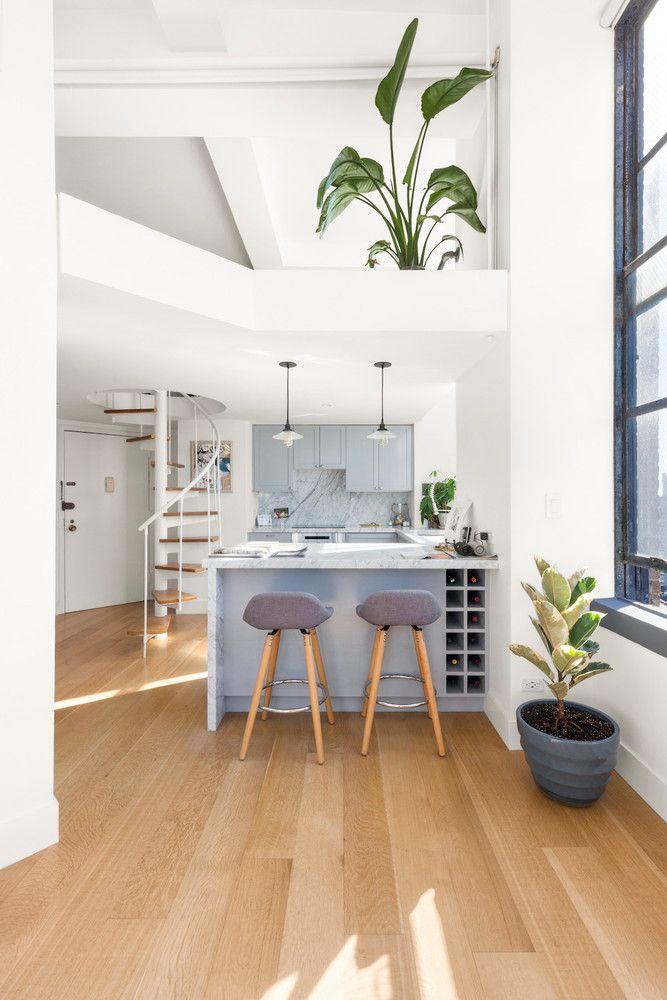 a Greenwich Village loft with a soft gray kitchen
