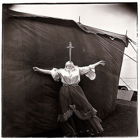Albino sword swallower at a carnival, 1970 by Diane Arbus.