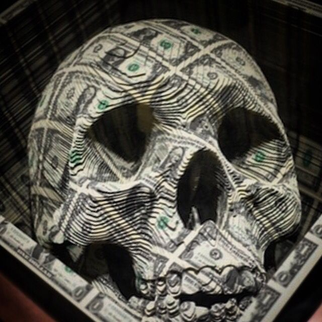 A skull which was shaped and designed by cutting stacks of uncut US money. Fukn amazing.