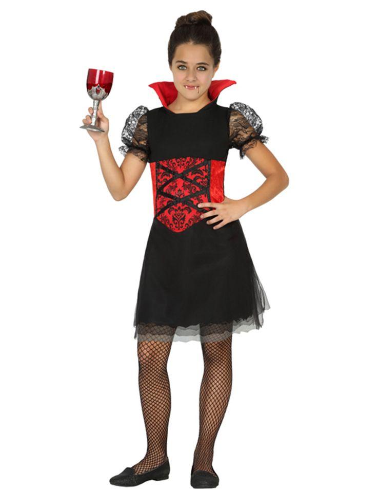 Disfraz vampiresa niña Halloween: Este disfraz de vampiro para niña incluye un vestido (enagua, vaso, colmillos, medias y zapatos no incluidos).El vestido es corto de color negro y rojo. Las mangas son cortas de encaje negro y...