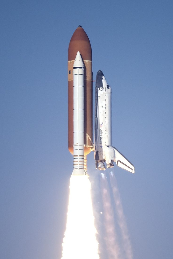 Space shuttle lifting off .