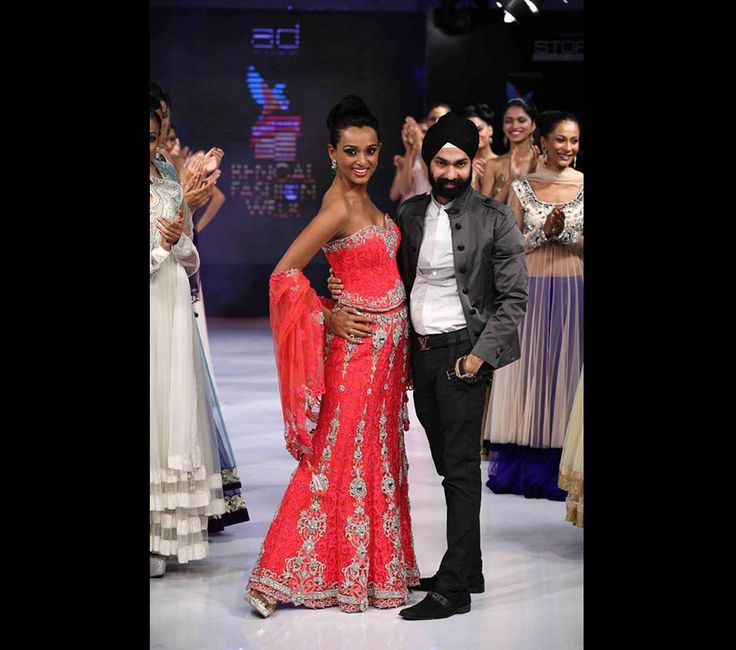 AD SIngh Fashion Show with reshmi ghosh doing honours in our signature coral lehenga  with a waist shaping corset in intricate resham & swarovki dust