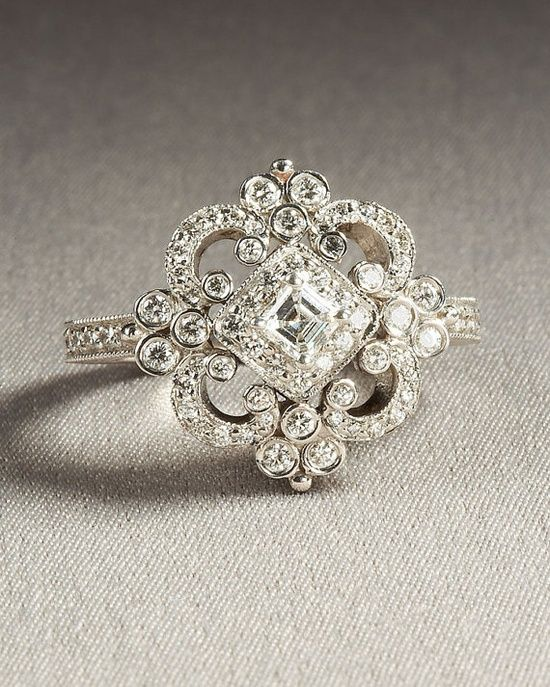 Love this ring! Just need to change the center to one larger diamond and it would be perfect!