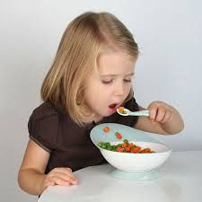 A child eating some vegetables.