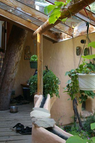 greenhouse attachment on cob cottage