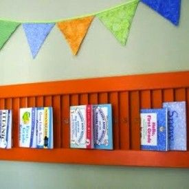 Book display 2 - Great idea to use old shutters to hold books in kids room