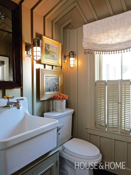 Small Bathrooms | House & Home painted  Putty on walls, deep farmhouse sink, bi-fold shutters, and marine style wall sconces