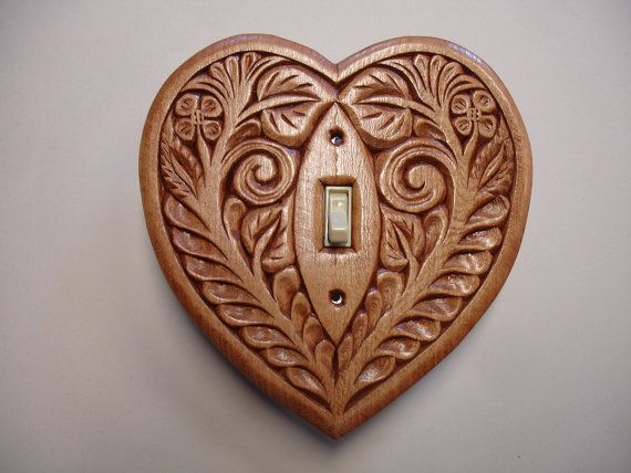 Heart shaped, hand carved wood, electric switch cover plate. Lovely in a modern space
