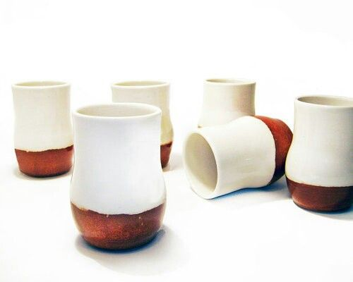 White and dark brown pottery cups
