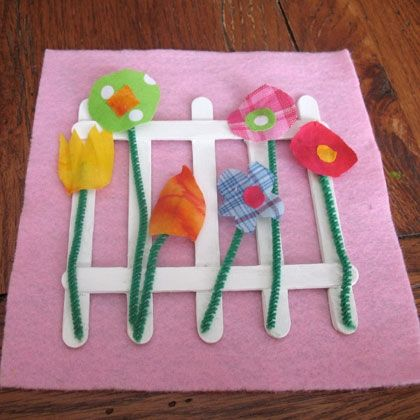 Fabric Scrap Flower Garden  Using craft sticks and fabric scraps, kids can create this fun and pretty flower garden activity with recycled materials – perfect for Earth Day.