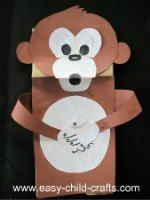 Make this paper bag puppet monkey.