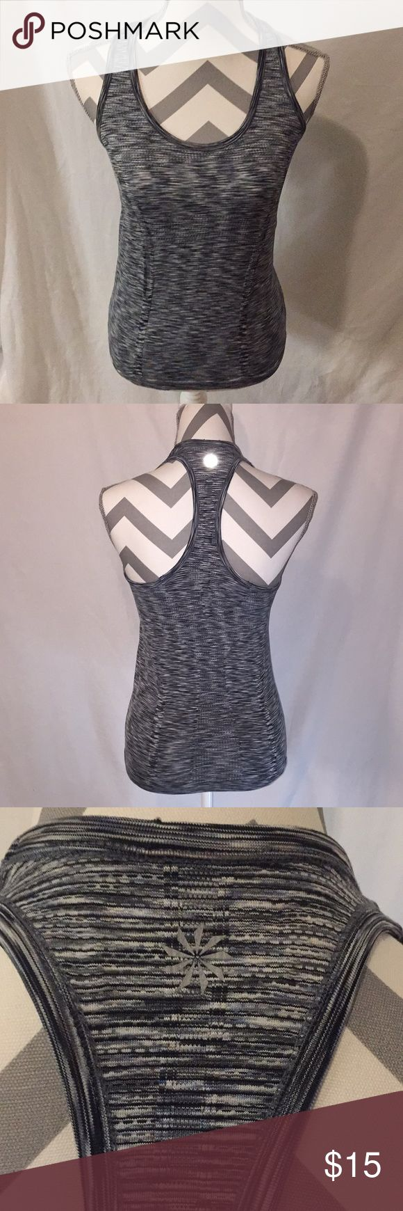 ATHLETA WOMENS FAST TRACK SPACE DYE TANK SIZE M Your favorite go to training tank for high intensity sweat sessions. Great for running, gym/training, and studio workouts. Racerback gives your arms freedom to move, has shirring along the sides so it fits to flatter, and has gripping dots along hem to stop it from riding up. Athleta Tops Tank Tops