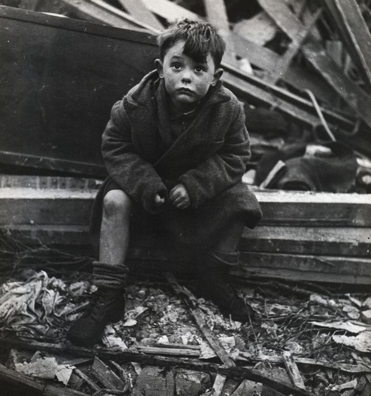 """I was told he had come back from playing and found his house a shambles—his mother, father and brother dead under the rubble…he was looking up at the sky, his face an expression of both confusion and defiance. The defiance made him look like a young Winston Churchill. This photograph was used by IBM to publicize a show in London. The boy grew up to become a truck driver after the war, and walking past the IBM offices, he recognized his picture."" WW 2"