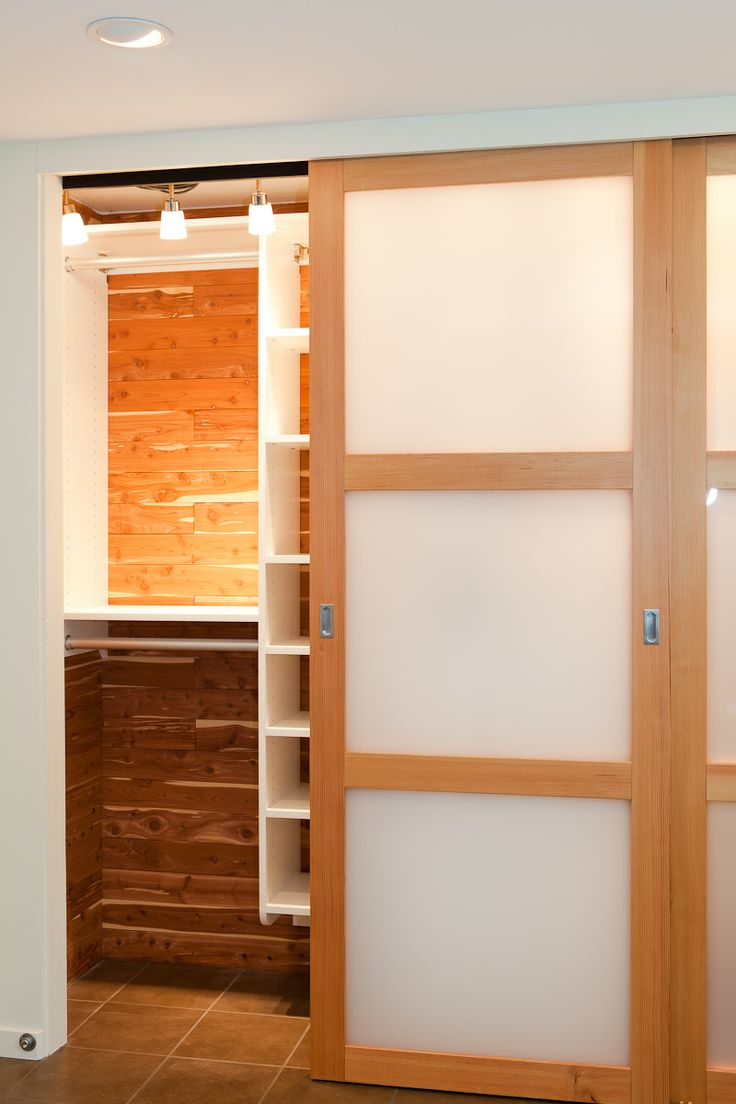 gray kat residential design studio - sliding translucent panel and fir doors - cedar lined closet