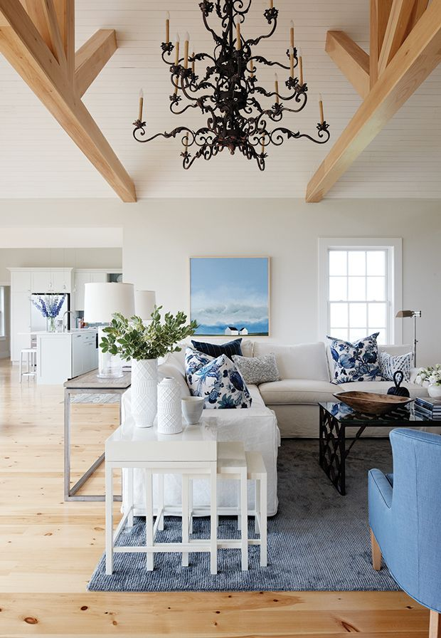 blue and white beach-inspired living room of PEI coastal country house by Sarah Richardson mixes new and vintage pieces
