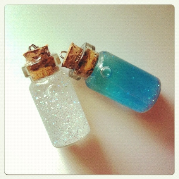 Mini Bottle Charms Blue and white sparkles. By Picture