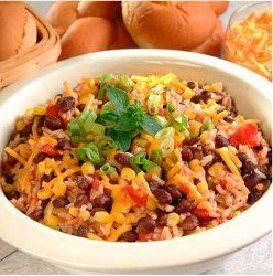 Enjoy as a side dish or as a main dish, this wonderfully seasoned rice recipe is perfect however you want eat it. Made with black beans, diced green chiles and topped with Cheddar cheese, you wont be able to deny it's excellence.
