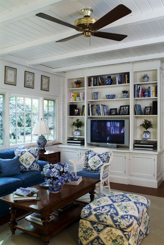 Blue and White Family Room. Will have white panel walls and navy blue couch and chair.