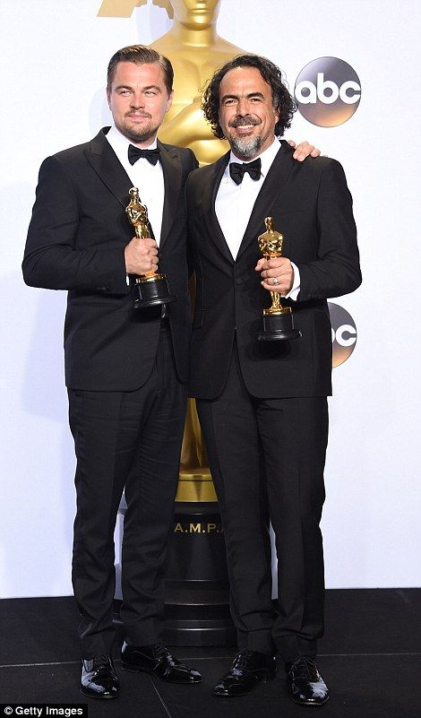 Golden man: Leo walked past the iconic Academy Awards statue proud in the knowledge that h...