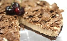 Toblerone cheesecake. Ingredients:  1 cup Choc Ripple biscuit crumbs  1/2 cup castor sugar  1/2 cup thickened cream  1/4 cup ground almonds  200g Toblerone milk or dark chocolate for shaving  200g Toblerone milk or dark chocolate, melted  500g cream cheese, sofftened  80g butter, melted
