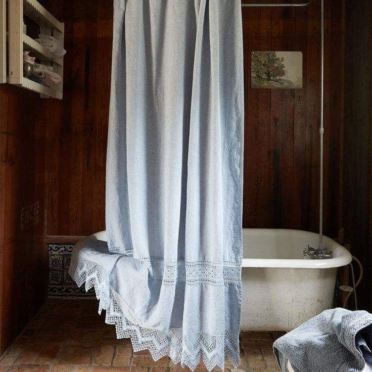 Add the Rachel Ashwell Cluny Lace Shower Curtain to your bath for the look of relaxed elegance. This soft, washed linen curtain features a banner of bobbin-style lace and a coordinating bottom trim with a zigzag edge. At top, 12 reinforced holes offer ease of hanging. Measures 74 x 72 in. Machine washable. 100% linen.