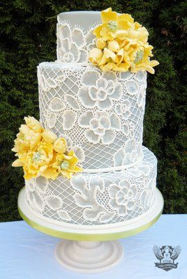 Grey and yellow lace wedding cake, featured in Portland Bride & Groom (winter/fall) edition