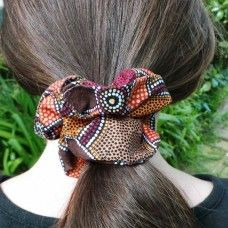Australia: Indigenous Scrunchie - Rust & Ochre. The ancient and beautiful colours of Australia are reflected in this Australian range of accessories. These are great to wear at ceremonies, music festivals or for daily use! Australia has a wealth of rich colours from the red centre, to rain forests and coastal shore – the  Australian Aborigines used these tones and painted their dreaming and songlines in their art. $9.00au, hand crafted in Australia by Ancient Realms.