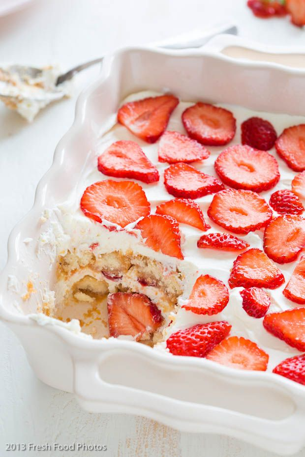 Strawberry Tiramisu - summery and truly delicious with orange strawberry sauce that you dip the lady fingers in and lots of whipped cream and strawberries, yum yum!