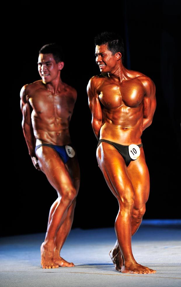 Two male bodybuilders strike a pose.