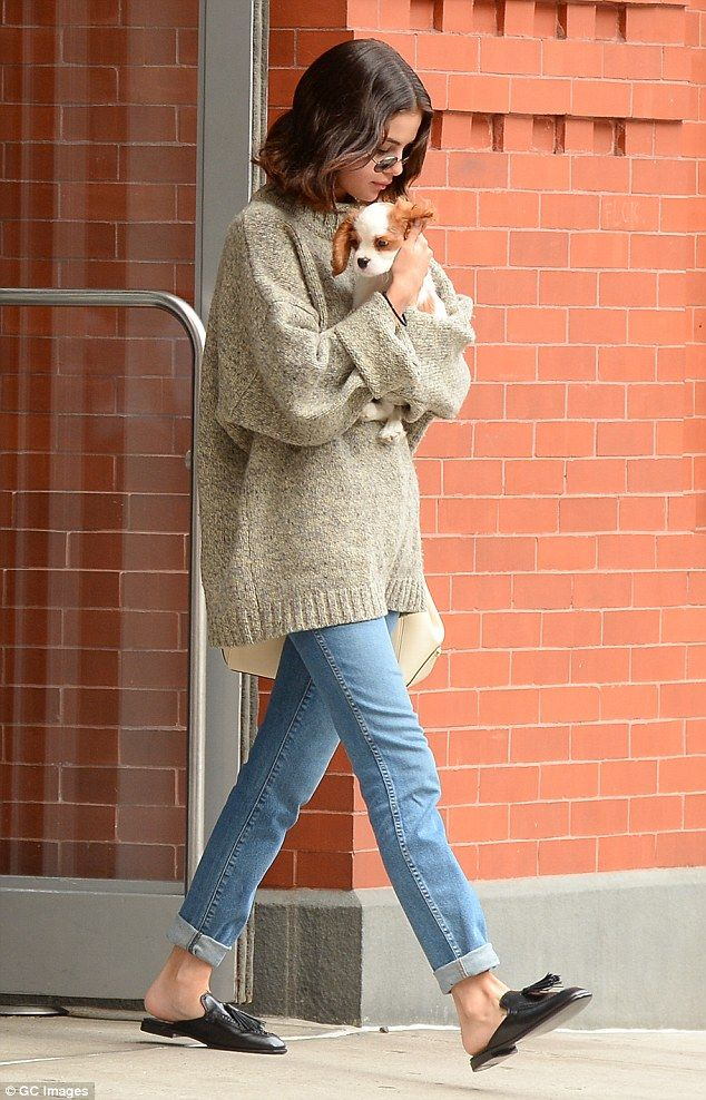 Selena Gomez looks downcast in NYC as she cradles puppy | Daily Mail Online