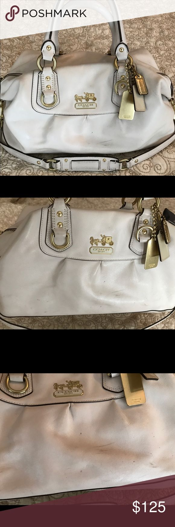 White Coach hobo bag. Good condition. Good condition white Coach hobo bag. Small scratches on front of bag. Lining in good condition with slight discoloration. Slight discoloration on back of bag. Discoloration can probably be removed with cleaning. Coach Bags Hobos