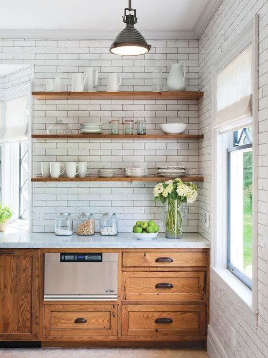 Open shelving in front of subway tile look great and can add to your overall kitchen design!