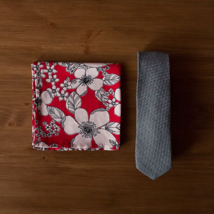 New to the shop today - a red floral cotton-silk pocket square, and a black and white classic and minimal wool tie.