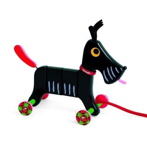 Crazy Scotty Wooden Pull Along  This fast and fun little black pull along toy dog is ready to go everywhere with your child! His bright red spring mounted tail wags as his tartan wheels, finished off with rubber to ensure he can keep up, roll on past as Crazy Scotty from Janod heads out on his next adventure.