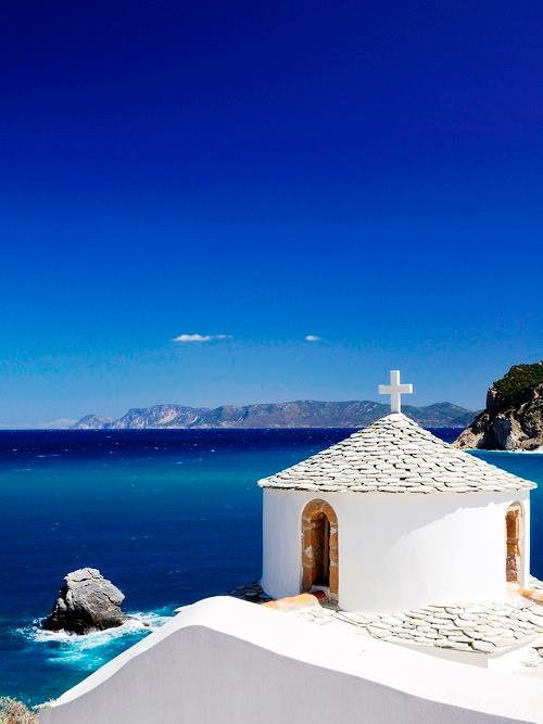 Skopelos Island, Inside the castle walls is the oldest church of the town, the 17th century basilica of Agios Athanassios whose initial edifice was built in the 9th century on the ruins of a temple dedicated to Athena. The panoramic view from the top of the castle is breathtaking and truly magical.