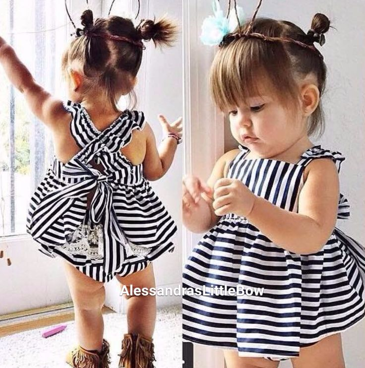 Stunning! This beautiful 2 piece white with navy blue stripped design swing set includes the top and bloomers. The top has criss cross straps adorned with beautiful ruffles made with the same fabric a