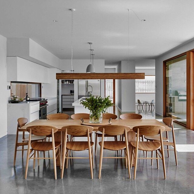 dining table with oak chairs by Mark Tuckey (marktuckey.com.au) make a statement in the beautiful Cowrie Rd house by MG Design & Building. Photo credit Blach Ford