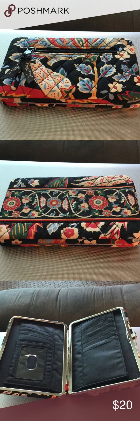Vera Bradley Clasp Fastener Skinny Wallet Nice clean wallet, great condition. Lots of card slots, zippered change holder outside. Red, blue cream floral. Vera Bradley Bags Wallets
