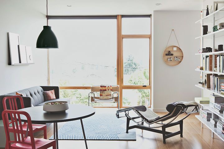 Bowie and Malboeuf's unit occupies three levels facing the property's backyard. The living-dining room has a mix of vintagepieces—a Wassily chair by Marcel Breuer and an LC4 chaise by Le Corbusier, Pierre Jeanneret, and Charlotte Perriand—alongside furniture from CB2.